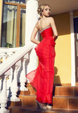 Beautiful young woman in luxurious red dress Royalty Free Stock Images