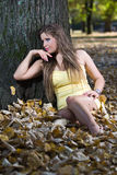 Beautiful young woman lying autumn leaves Royalty Free Stock Photo