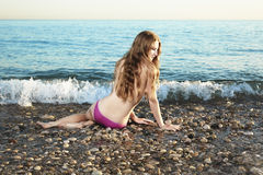 Beautiful young woman lying on the beach royalty free stock photos