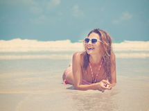 Beautiful young woman lying on the beach against the sea Royalty Free Stock Photos