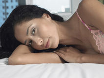 Beautiful Young Woman Lying In Bed Royalty Free Stock Photos