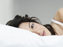 Beautiful Young Woman Lying In Bed Stock Images