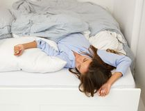 Beautiful young woman lying in bed sleeping Royalty Free Stock Photos