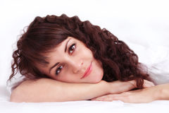Beautiful young woman lying on a bed Royalty Free Stock Photo