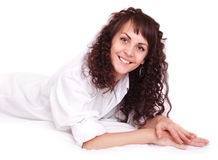 Beautiful young woman lying on a bed Royalty Free Stock Photography