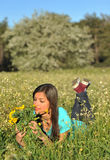 Beautiful young woman lying in blooming meadow Royalty Free Stock Photo