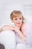 Beautiful young woman lying in a chair Royalty Free Stock Image