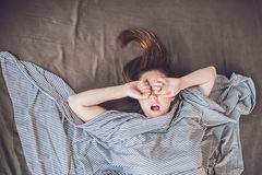 Beautiful young woman lying down in bed and sleeping, top view. Do not get enough sleep concept Stock Photo