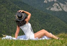 Beautiful young woman lying on a field stock photo