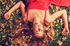 Beautiful Young Woman Lying in Flowers Royalty Free Stock Photography