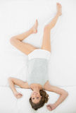 Beautiful young woman lying in her bed in the bedroom Royalty Free Stock Images