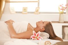 Beautiful woman sleeping on massage bed Stock Photo