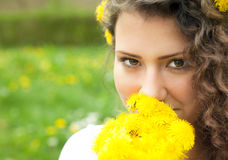 Beautiful Young Woman lying in Meadow of Flowers. Enjoy Nature Royalty Free Stock Images