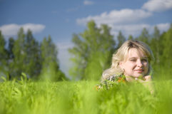 Beautiful young woman lying on the nature Royalty Free Stock Photography