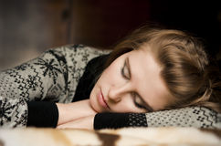 Beautiful young woman lying on a sofa in her arms Royalty Free Stock Photography