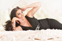 Young woman lying on  bed Stock Image
