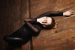 Beautiful young woman lying on the wooden steps Royalty Free Stock Photos