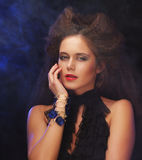 Beautiful young woman with magnificent hairdo. Close up Royalty Free Stock Photos