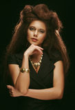 Beautiful young woman with magnificent hairdo. Close up Royalty Free Stock Images