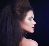 Beautiful young woman with magnificent hairdo. Close up Royalty Free Stock Photography