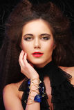 Beautiful young woman with magnificent hairdo. Close up Royalty Free Stock Photo