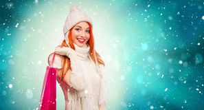 Shopping woman holding color bags and on winter background with cnow in black friday, Christmas and New Year holidays Stock Images