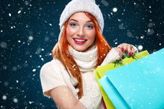 Christmas and New Year holidays.. Shopping woman holding color bags and on winter background with snow in black friday Stock Photo