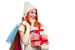 Christmas and New Year holidays. Happy woman holding gift boxes and bags after shopping on white background in black Stock Photography