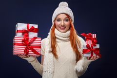 Christmas and New Year holidays. Happy woman holding gift boxes on winter background in black friday. Sales on christmas. Beautiful young woman make shopping in stock images