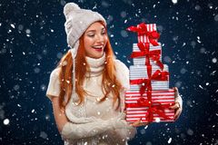 Christmas and New Year holidays. Happy woman holding gift boxes on winter background with snow in black friday. Sales on Stock Photo