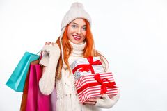 Shopping woman holding color bags and gift box on white background in black friday, Christmas and New Year holidays Royalty Free Stock Photography