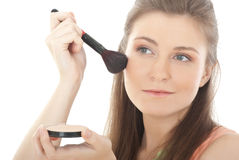Beautiful young woman with a make-up brush Royalty Free Stock Image