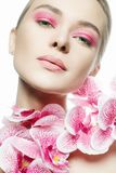 Beautiful young Woman with Make-up and Flower Royalty Free Stock Images