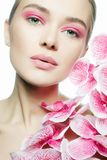 Beautiful young Woman with Make-up and Flower Stock Photo