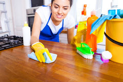 Beautiful young woman makes cleaning the house. Girl cleaning ki. Tchen. Set Stock Photos