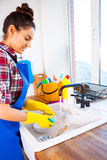 Beautiful young woman makes cleaning the house. Girl cleaning ki. Beautiful young woman makes cleaning the house. Girl washes the dishes. Set Stock Image