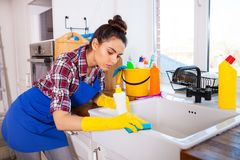 Beautiful young woman makes cleaning the house. Girl cleaning kitchen. Set. royalty free stock photos