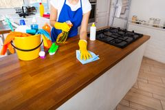 Beautiful young woman makes cleaning the house. Girl cleaning kitchen. Set. stock images