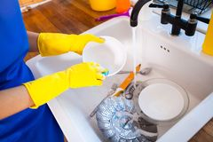 Beautiful young woman makes cleaning the house. Girl cleaning kitchen. Set. Beautiful young woman makes cleaning the house. Girl washes the dishes. Set royalty free stock photography