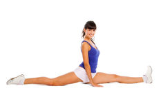 Beautiful young woman makes split. Isolated over white background Stock Photography
