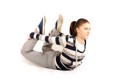 Beautiful young woman makes stretching Stock Images