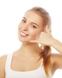 Beautiful young woman making a call me gesture Stock Photography