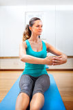 Beautiful Young woman making fitness exercises stretching Stock Image