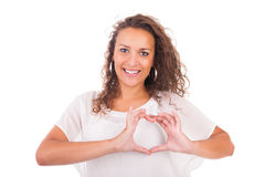 Beautiful young woman making a heart with hands Stock Photography