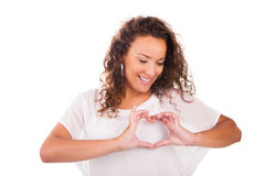 Beautiful young woman making a heart with hands royalty free stock photography