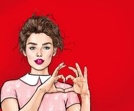 Beautiful Young Woman Making Heart With Her Hands On Red Background. Positive Human Emotion Expression Feeling Life Body Language. Stock Photography