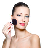 Beautiful young woman making make-up Royalty Free Stock Photography