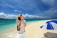 Beautiful young woman making photo using slr stock photography