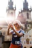 Beautiful young woman making selfy photo on her phone. Stock Photo