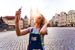 Beautiful young woman making selfy photo on her phone. Royalty Free Stock Images